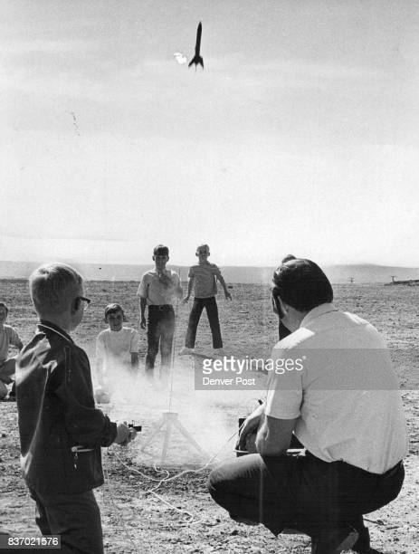 Rick Beatty of 12835 W Alameda Drive pushes the button while Robert Pritchett the teacher supervises the test The rocket heads for the sky to the...