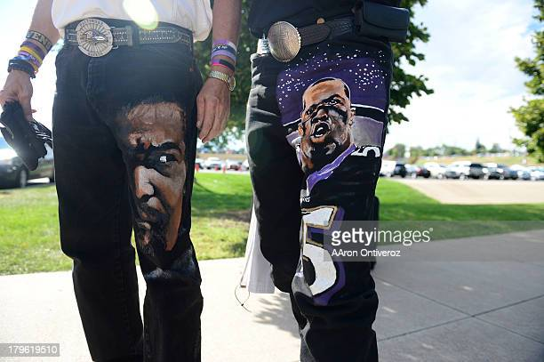 Rick Bowlus left and Brian Donley right sport painted pants as they head towards the stadium The Denver Broncos took on the Baltimore Ravens in the...