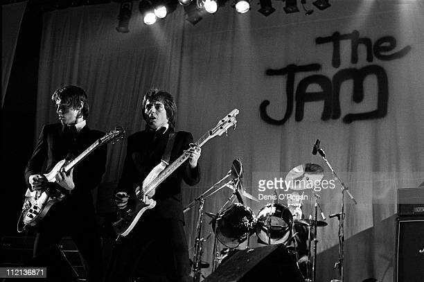 Rick Buckler Bruce Foxton and Paul Weller of the Jam in concert 1977