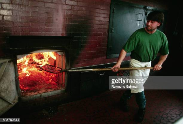 rick byrd stoking the barbecue fire - stoking stock pictures, royalty-free photos & images