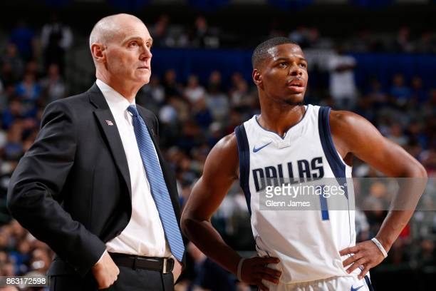 Rick Carlisle and Dennis Smith Jr #1 of the Dallas Mavericks look on during the game against the Atlanta Hawks at the American Airlines Center in...