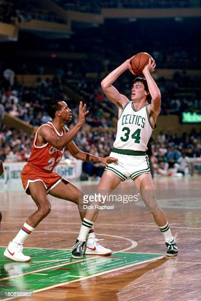 Rick Carlisle of the Boston Celtics looks to pass the ball while defended by Michael Wilson of the Cleveland Cavaliers during a game circa 1985 at...
