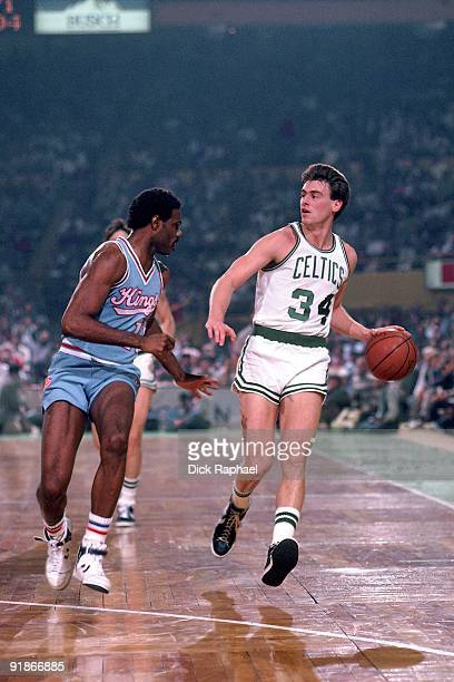 Rick Carlisle of the Boston Celtics moves the ball up court against the Sacramento Kings during a game played in 1986 at the Boston Garden in Boston...