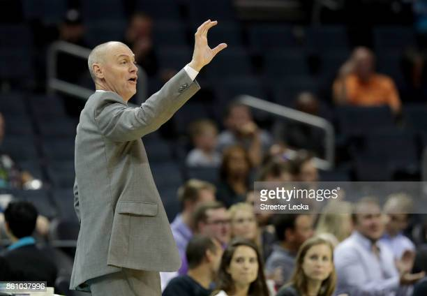 Rick Carlisle of the Dallas Mavericks calls a play during their game against the Charlotte Hornets at Spectrum Center on October 13 2017 in Charlotte...