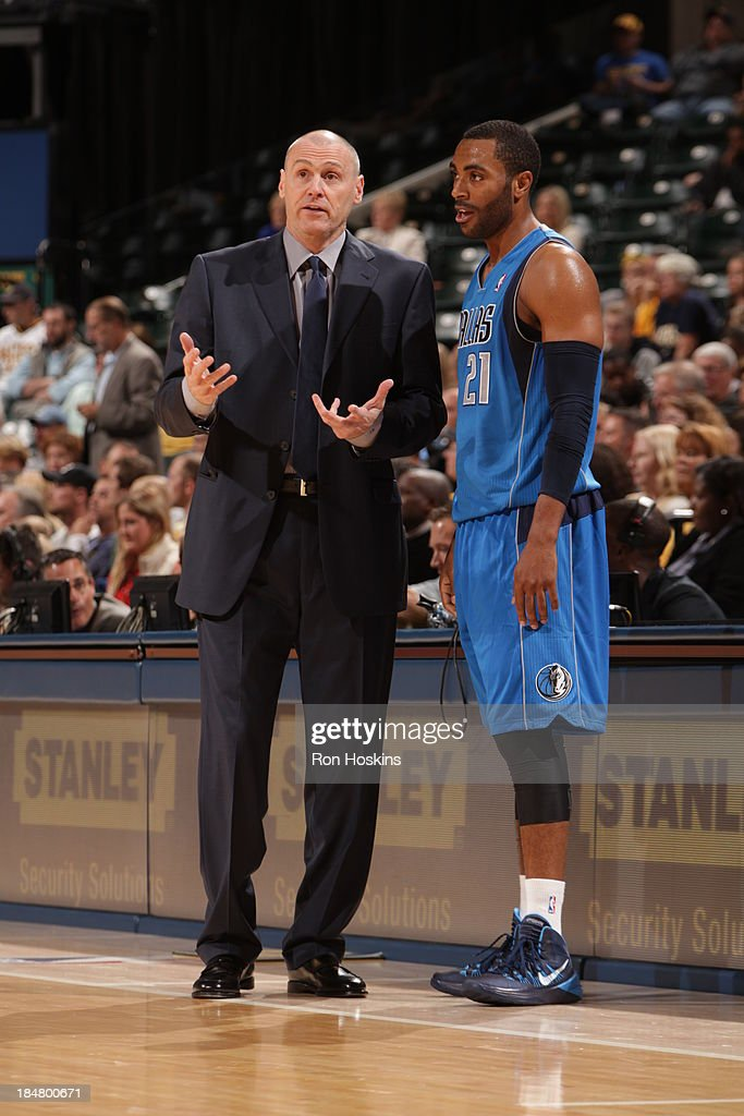 Rick Carlisle of the Dallas Mavericks shares a word with Wayne Ellington #21 during the game against the Indiana Pacers at Bankers Life Fieldhouse on October 16, 2013 in Indianapolis, Indiana.