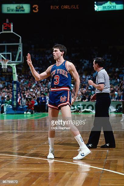 Rick Carlisle of the New York Knicks stands on the court against the Boston Celtics during a game played in 1988 at the Boston Garden in Boston...