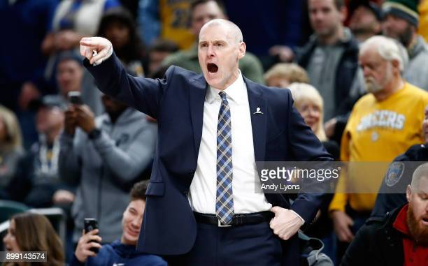 Rick Carlisle the head coach of the Dallas Mavericks gives instructions to his team against the Indiana Pacers during the game at Bankers Life...