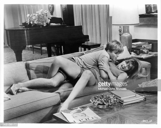 Rick Chalet climbs on top of Cristina Ferrare as she fights to get him off of her in a scene from the film 'Impossible Years' 1968