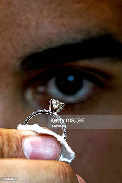 Rick Chavez a jewelry consultant examines a diamond ring for Brilliant Earth which uses conflictfree diamonds from Canadian mines in San Francisco...