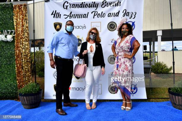Rick Clark and Julie Bates of Macys, and Susan Smallwood, producer of Grandiosity Events Cigars & Guitars Charity Polo & Jazz charity event, appear...