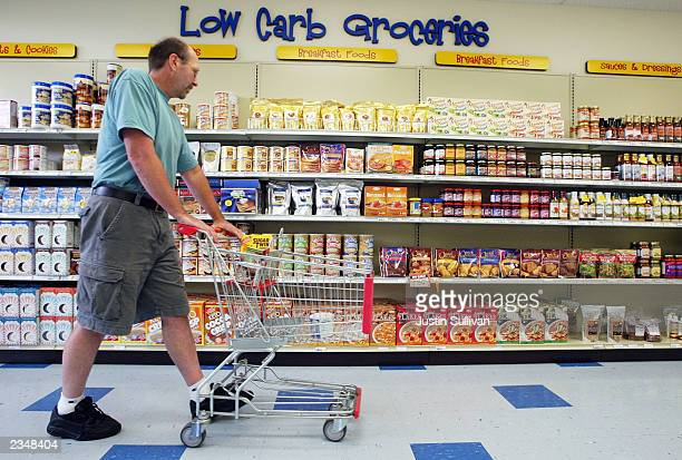 Rick Curia of Hayward California shops at the Castus Low Carb Superstore July 30 2003 in Fremont California Castus owner Rick Schott started his...