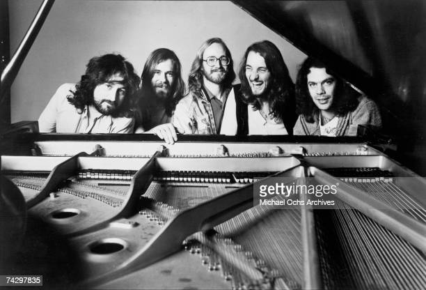Rick Davies Dougie Thomson John A Helliwell Roger Hodgson and Bob C Benberg of the rock band 'Supertramp' pose for a portrait sitting at a piano in...