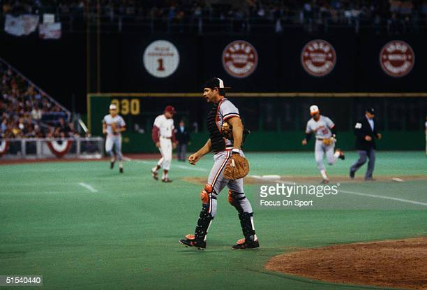 Rick Dempsey catcher for the Baltimore Orioles walks to the dugout after action at home against the Philadelphia Phillies during the World Series at...