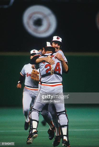 Rick Dempsey grabs Scott McGregor of the Baltimore Orioles after defeating the Philadelphia Phillies during the World Series at Veterans Stadium in...