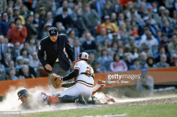 Rick Dempsey of the Baltimore Orioles applies the tag at home against the Chicago White Sox at Memorial Stadium circa 1982 in Baltimore Maryland
