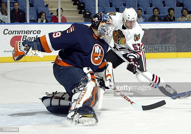 Rick DiPeitro of the New York Islanders defends against Karl Stewart of the Chicago Blackhawks on October 31, 2006 at Nassau Coliseum in Uniondale,...