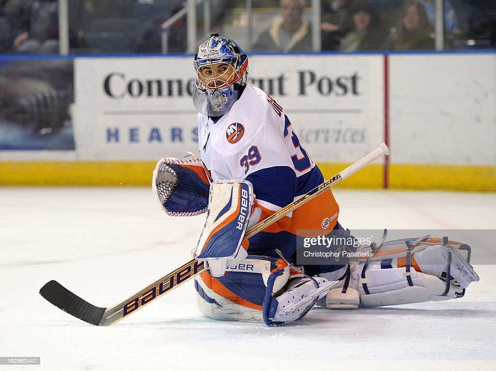 Rick DiPietro #39 of the Bridgeport Sound Tigers looks back after deflecting a shot on goal during an American Hockey League game against the Adirondack Phantoms on March 2, 2013 at the Webster Bank Arena at Harbor Yard in Bridgeport, Connecticut.