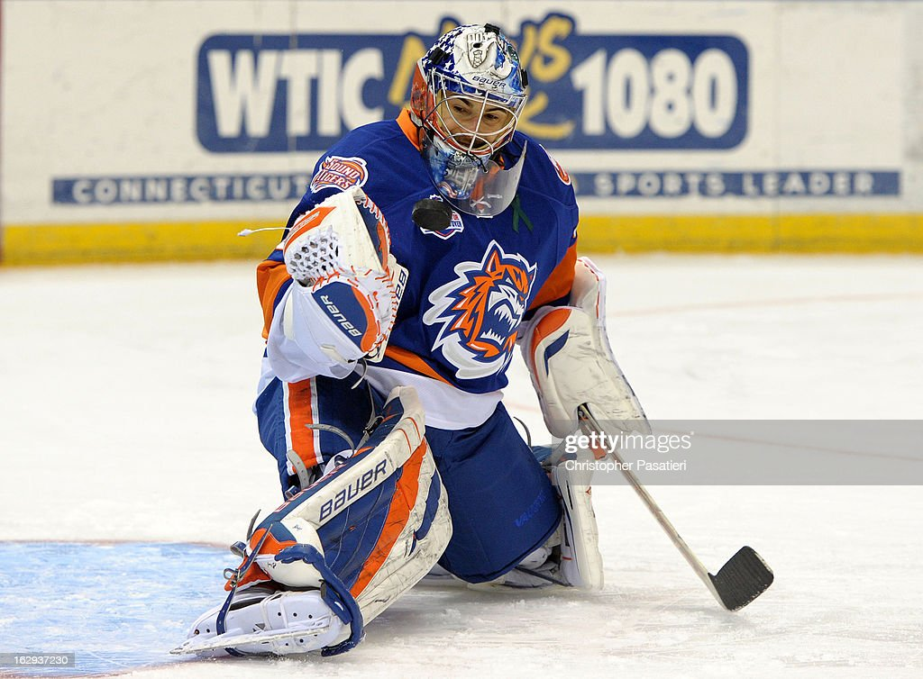 Rick DiPietro #39 of the Bridgeport Sound Tigers makes a save prior to the game against the Connecticut Whale on March 1, 2013 at the XL Center in Hartford, Connecticut.