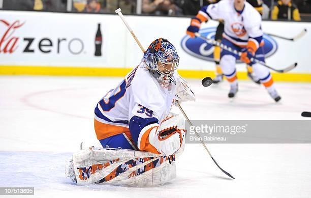 bd0f43990 Rick DiPietro of the New York Islanders catches the puck against the Boston  Bruins at the