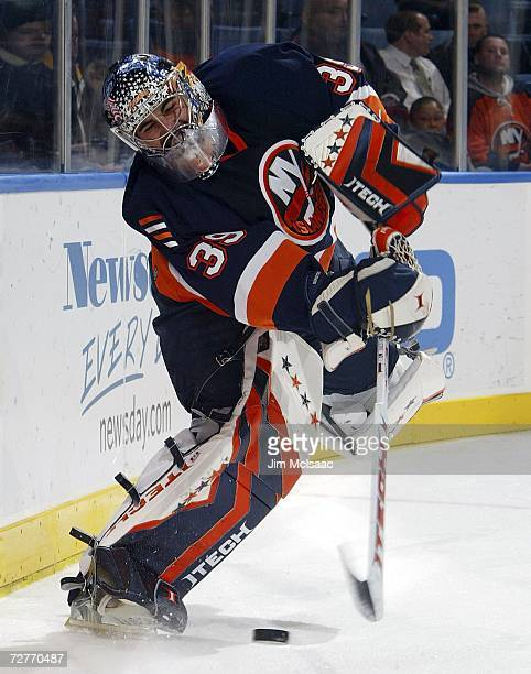Rick DiPietro of the New York Islanders clears the puck against the Montreal Canadiens during their game on December 7, 2006 at Nassau Coliseum in...