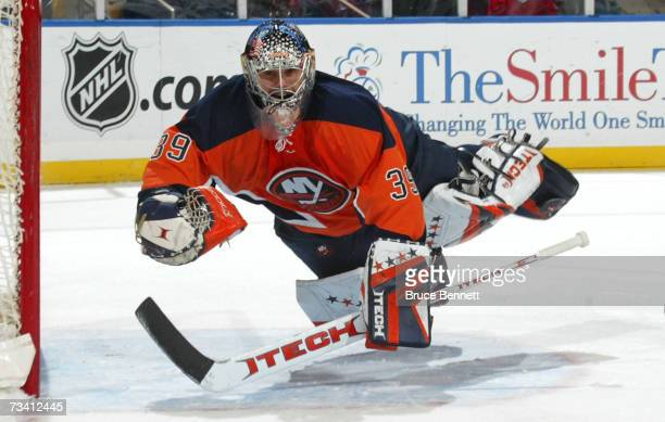 Rick DiPietro of the New York Islanders flies across the crease against the Montreal Canadiens on February 24, 2007 at the Nassau Coliseum in...