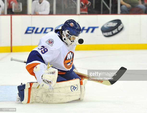 09c1c23a2 Rick DiPietro of the New York Islanders stops a shot on goal during the  second period