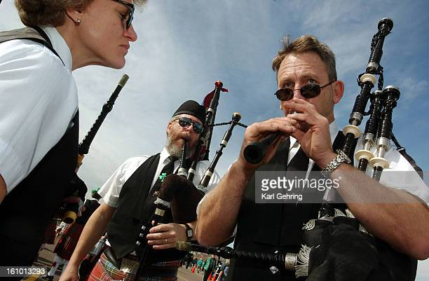 Rick Draudt <cq> right tuned the chanter of his bagpipe before the 42nd annual Denver St Patrick's Day parade Saturday morning Draudt is a bagpiper...