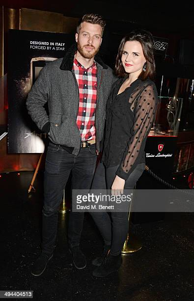 Rick Edwards and Emer Kenny attend the launch of the Tonino Lamborghini Antares Smartphone at No 41 Mayfair on May 29 2014 in London England