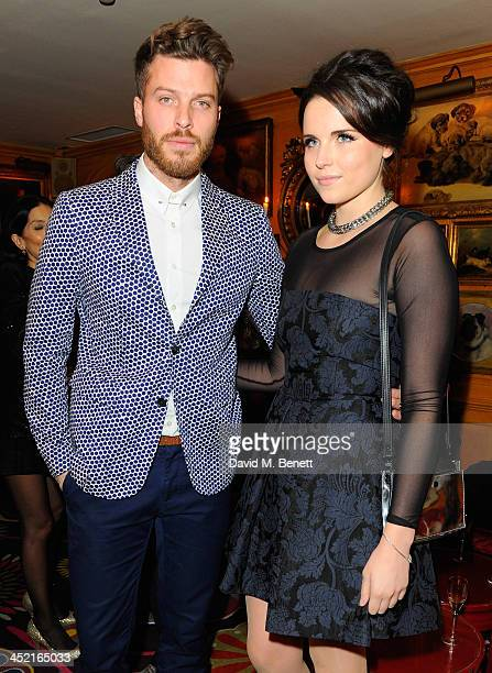 Rick Edwards and guest attend Veuve Clicquot Style Party at Annabel's on November 26 2013 in London England
