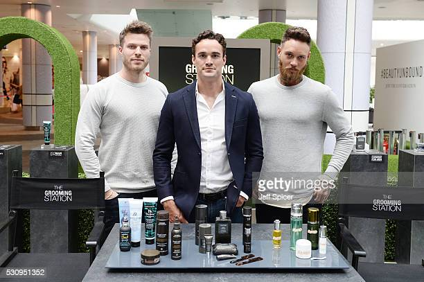 Rick Edwards Thom Evans and Bill Huxley enjoy the Esquire Grooming Station at Westfield London on May 11 2016 in London England
