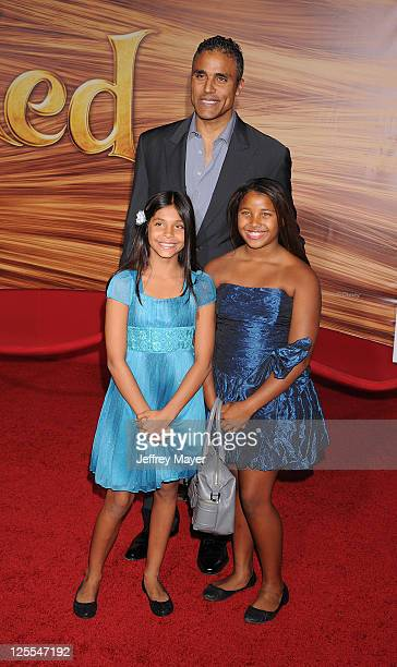 Rick Fox and daughter Sasha attend the Tangled Los Angeles Premiere at the El Capitan Theatre on November 14 2010 in Hollywood California