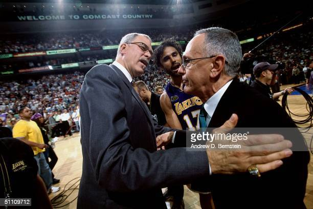 Rick Fox and Head Coach Phil Jackson of the Los Angeles Lakers talks to Head Coach Larry Brown of the Philadelphia 76ers after the game circa 2001 in...