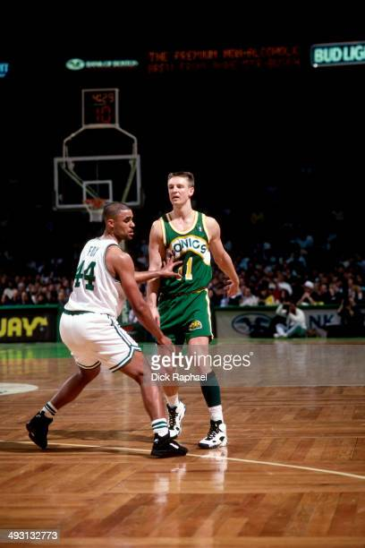 Rick Fox of the Boston Celtics defends Detlef Schrempf of the Seattle SuperSonics during a game played circa 1994 at the Boston Garden in Boston...
