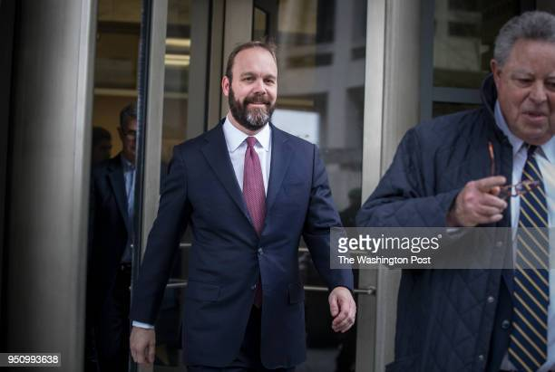 Rick Gates a former top official in Trump's campaign leaves the Federal courthouse with his lawyer Tom Green in Washington DC February 23 after...
