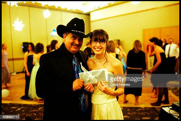 Rick Goeringer and his daughter Lacey hold a pledge of abstinence at a Purity Ball in Spearfish South Dakota Purity Balls have grown in popularity as...