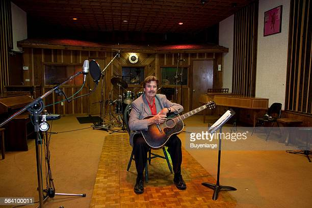 Rick Hall founder of FAME Recording Studios sitting in the FAME studio in Muscle Shoals Alabama
