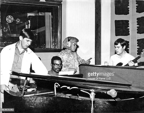 Rick Hall Marvell Thomas R and B singer Etta James and David Hood recording at Fame Studios circa 1967 in Muscle Shoals Alabama