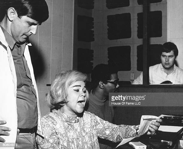Rick Hall R and B singer Etta James Marvell Thomas and David Hood recording at Fame Studios circa 1967 in Muscle Shoals Alabama