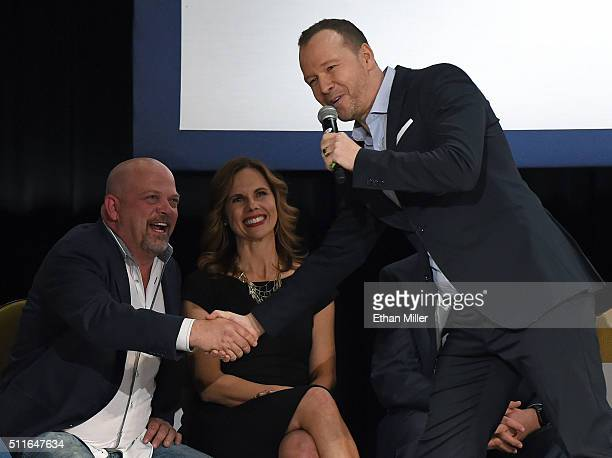 Rick Harrison from History's Pawn Stars television series shakes hands with singer/actor Donnie Wahlberg as Julie Chaffetz wife of US Rep Jason...