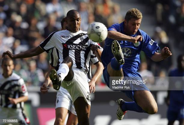 Rick Hoogendorp of Wolfsburg and Marvin Compper of Monchengladbach battle for the ball during the Bundesliga match between Borussia Monchengladbach...
