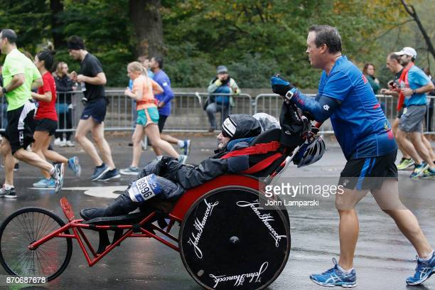 Rick Hoyt and Dick Hoyt run at mile 25 during the 2017 TCS New York City Marathon on November 5 2017 in New York City
