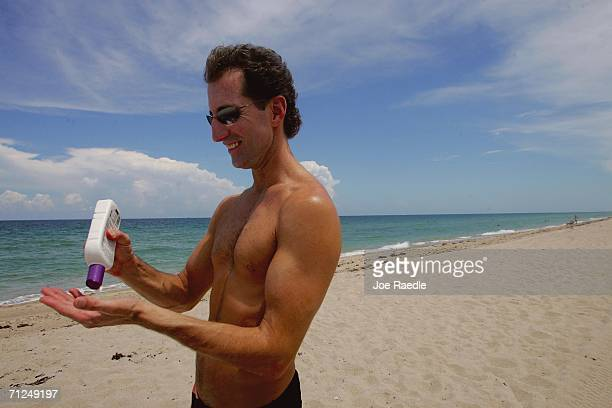 Rick Johnson applies sun tan lotion during a visit to the beach June 20 2006 in Fort Lauderdale Florida Recent studies have shown that the best way...