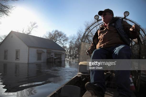 Rick Johnson helps residents recover possessions from their flooded homes on March 21 2019 in Craig Missouri The town of Craig is completely...