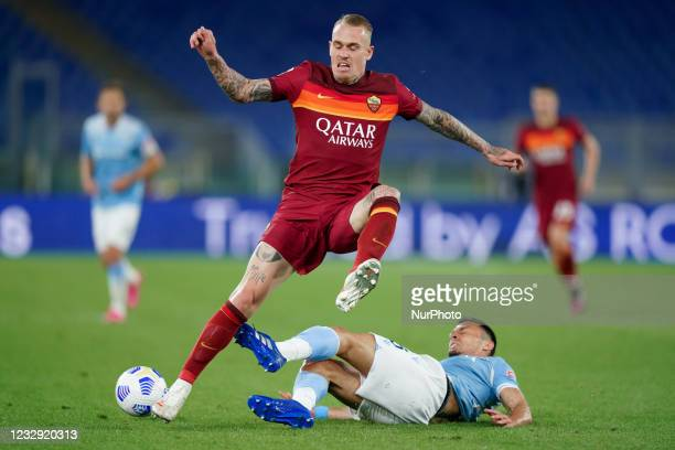 Rick Karsdorp of AS Roma and Stefan Radu of SS Lazio compete for the ball during the Serie A match between AS Roma and SS Lazio at Stadio Olimpico,...