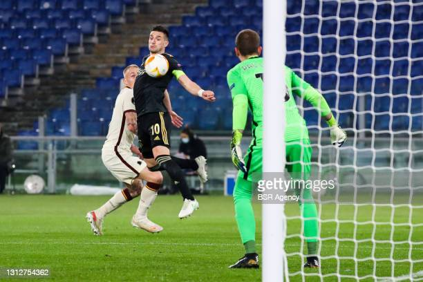 Rick Karsdorp of AS Roma, Dusan Tadic of Ajax and goalkeeper Pau Lopez of AS Roma during the UEFA Europa League Quarter Final: Leg Two match between...