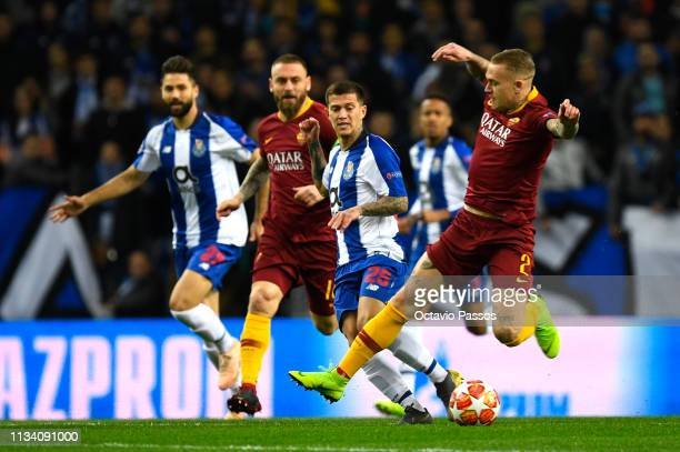 Rick Karsdorp of AS Roma tackles Otavio of FC Porto uring the UEFA Champions League Round of 16 Second Leg match between FC Porto and AS Roma at...