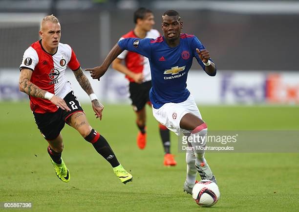 Rick Karsdorp of Feyenoord chases down Paul Pogba of Manchester United during the UEFA Europa League Group A match between Feyenoord and Manchester...