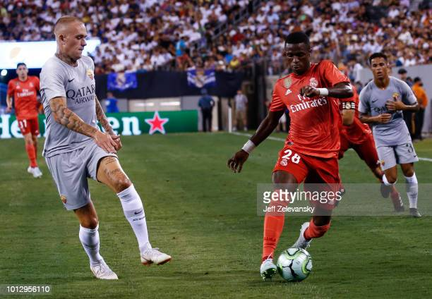 Rick Karsdorp of Roma defends Vinicius Junior of Real Madrid during their match at MetLife Stadium on August 7 2018 in East Rutherford New Jersey