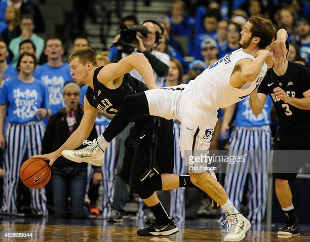 Rick Kreklow of the Creighton Bluejays tries not to foul Austin Etherington of the Butler Bulldogs during a game at CenturyLink Center February 16...