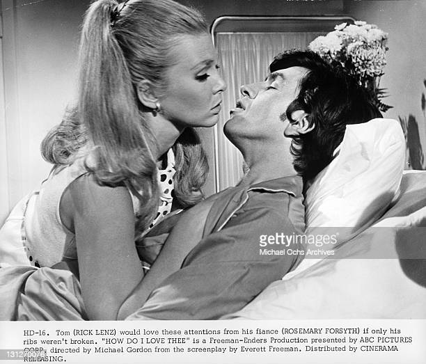 Rick Lenz would love the attentions from his fiancé Rosemary Forsyth if only his ribs weren't broken in a scene from the film 'How Do I Love Thee'...